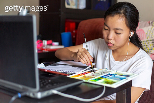young girl painting in the living room - gettyimageskorea