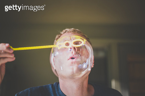Man Blows Bubble - gettyimageskorea