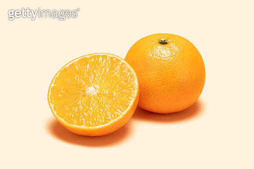 Orange and Cross Section on Colored Background - gettyimageskorea