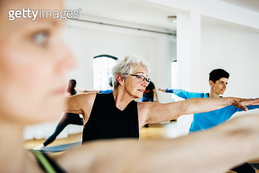 Mature Woman Practicing Yoga - gettyimageskorea