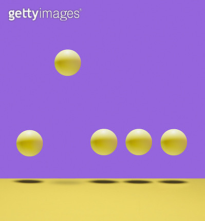 5 yellow balls bouncing on yellow surface, 1 ball much higher than other 4, purple background - gettyimageskorea