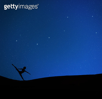 Ballerina dancing under the starry sky - gettyimageskorea