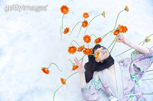 Snow, Orange Flowers, One Woman Only, Outdoors, Black Long Hair - gettyimageskorea