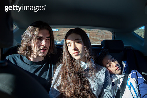 Portrait Of Siblings Sitting In Car - gettyimageskorea