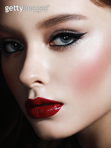 Portrait of beautiful woman with blue eyeshadows and bright lip gloss - gettyimageskorea