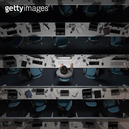 One office worker working in an empty, dark office - gettyimageskorea