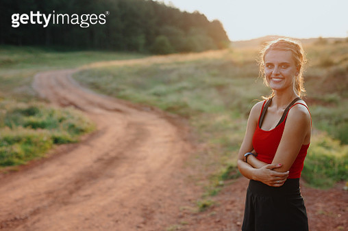 Confident young woman working out in the nature - gettyimageskorea