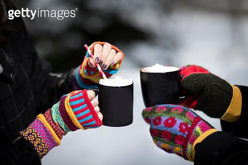 Winter Scene of Hot cocoa and girls hands in mittens - gettyimageskorea