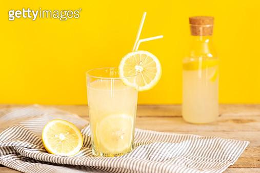 Homemade lemonade in mason jars with big green paper straw - gettyimageskorea