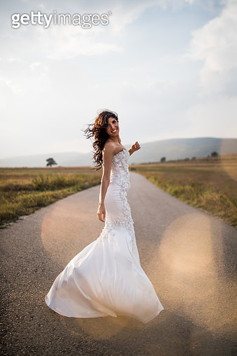 Bride on the country road - gettyimageskorea