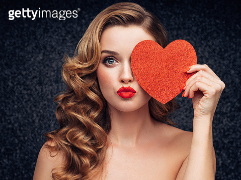Beautiful woman with heart symbol - gettyimageskorea