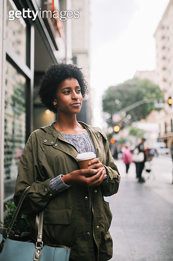 young woman having a coffee to go in downtown Los Angeles - gettyimageskorea