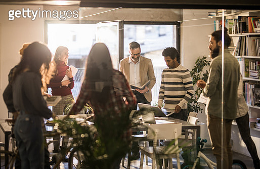 Large group of happy freelancers working at casual office. - gettyimageskorea