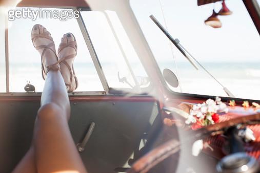 Woman relaxing in camper van, legs only - gettyimageskorea