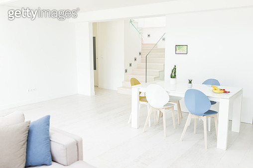 Modern living room with smart home device on wall - gettyimageskorea