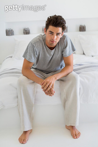 Man sitting on the bed - gettyimageskorea