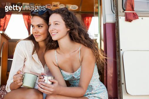 Women relaxing in camper van - gettyimageskorea