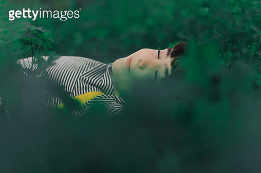 Portrait of little girl resting in nature - gettyimageskorea