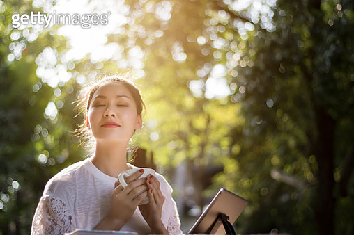 Close-Up Of Young Woman Holding Cup Outdoors - gettyimageskorea