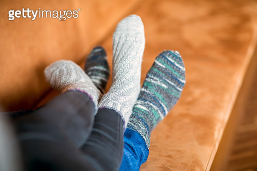 Feet of couple in love lying on couch - gettyimageskorea
