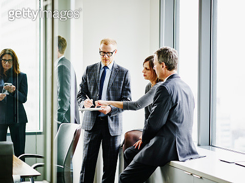 Business executives collaborating on project - gettyimageskorea