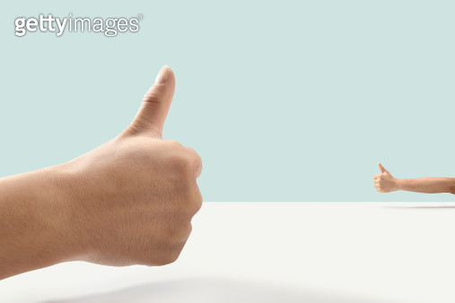 Thumb up and Thumb up - gettyimageskorea