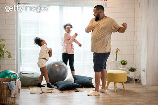 African father and his two daughter morning exercise at home. - gettyimageskorea