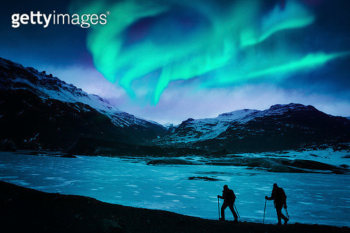 Hikers Under the Northern Lights - gettyimageskorea