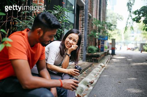 Friends chatting outdoors in Kuala Lumpur, Malaysia - gettyimageskorea