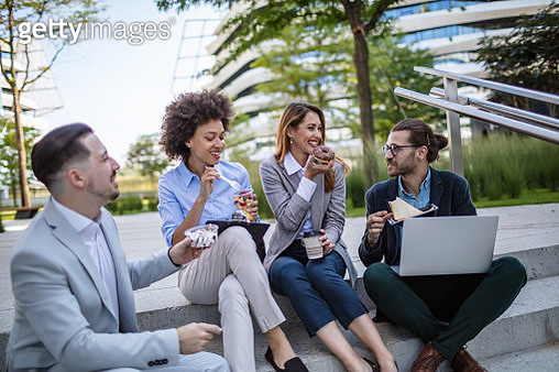 Group of young business people having lunch outdoors - gettyimageskorea