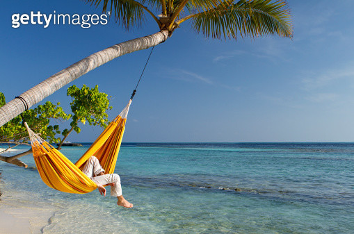 Hammock relaxation by the sea - gettyimageskorea