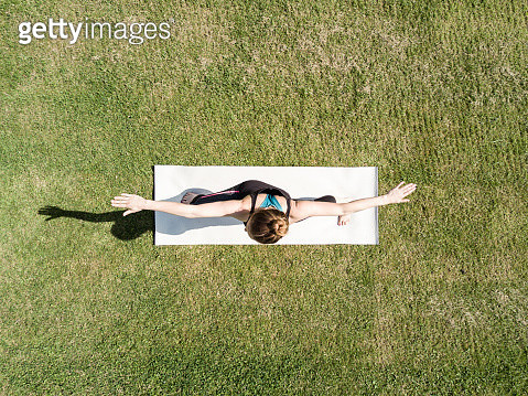 Young woman performing yoga in a park - gettyimageskorea