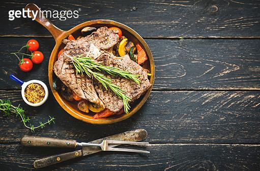 Grilled beef steak on dark wooden table background, top view - gettyimageskorea