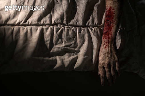 Directly Above Shot Of Zombie Hand On Bed - gettyimageskorea