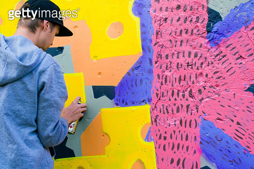 Rear View Of Street Artist Painting Wall With Spray Paint - gettyimageskorea