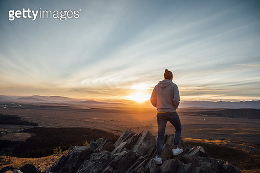 Rear View Of Man Standing On Cliff - gettyimageskorea