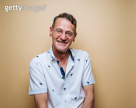 Middle-aged man on yellow background - gettyimageskorea