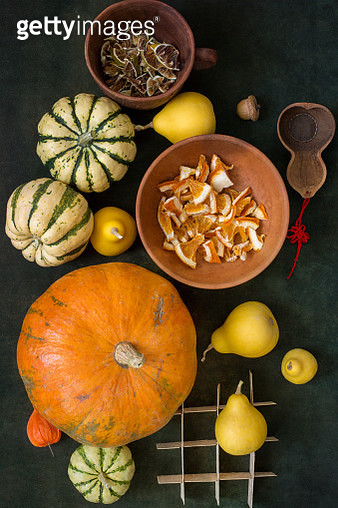 View from above of pumpkins and slices of dried orange and lemon - gettyimageskorea