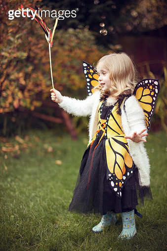 A little girl is dressed as a butterfly for Halloween - gettyimageskorea