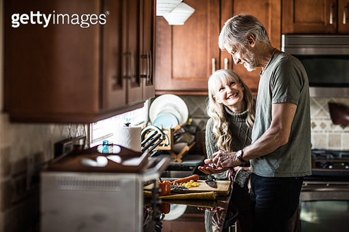 Portrait of couple (60yrs) cooking at home - gettyimageskorea