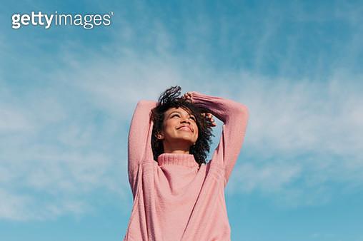 Portrait of happy young woman enjoying sunlight - gettyimageskorea