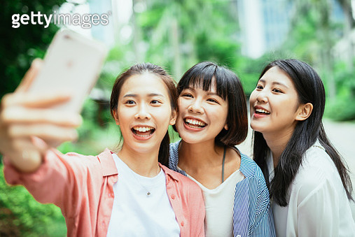 Young Taiwanese and Chinese women spending time together and enjoying their leisure time and activities. - gettyimageskorea