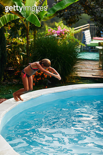 Girl jumping in to the pool - gettyimageskorea