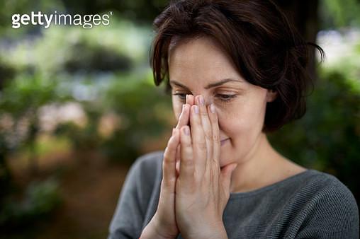 Portrait of brunette woman contemplating - gettyimageskorea