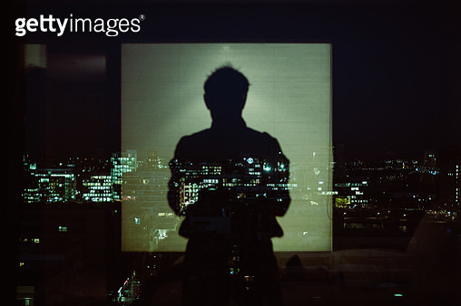 Reflection Of Silhouette Man On Glass Window At Night - gettyimageskorea