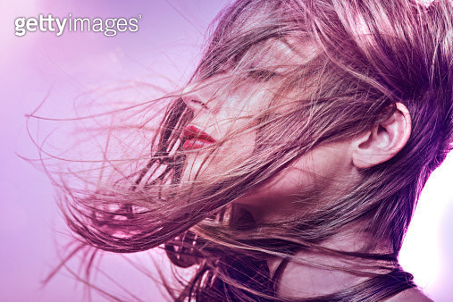 brunette woman with hair sweeping over her face - gettyimageskorea