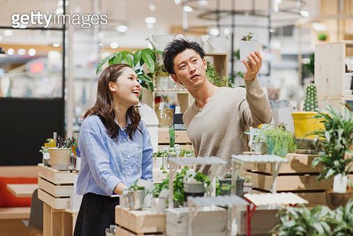 Young couple shopping dairy products at supermarket. - gettyimageskorea