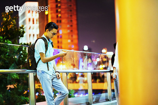 Young businessman is using smartphone - gettyimageskorea