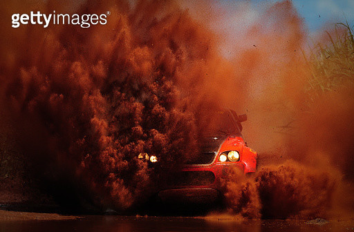 Car covered with dirt at cross country race, Barretos, Sao Paulo State, Brazil - gettyimageskorea