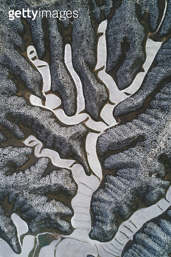 Drone shot of twisting field patterns in the mountains, Aragon, Spain - gettyimageskorea